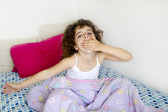 Awakening girl yawning bed messy morning hair Royalty Free Stock Photography