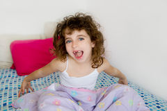 Awakening girl yawning bed messy morning hair. Awakening girl brunette happy in her bedroom bed with messy hair Royalty Free Stock Image