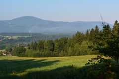 Awakening mountin. Beautiful morning rays of the sun in the forest Stock Photo