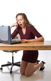 Awakes with a yawn. Young woman tired from computer work Royalty Free Stock Photo