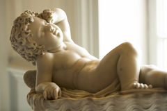 Awaking Cherub Stock Images