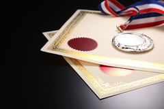 Award. Blank certificate with silver medal Stock Photos