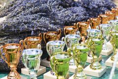 Award cups and lavender bouquets. The prices at a competition royalty free stock images