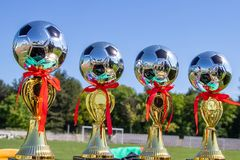 Award cups young footballers. Cups award young football players of the championship stock photography