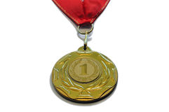 Award medal of gold color and red ribbon Royalty Free Stock Images