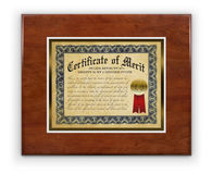 Award Plaque. Award certificate laminated on wood hanging on a white wall, isolated with a clipping path Royalty Free Stock Photos