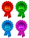 Award ribbon rosette. Color award ribbon rosette isolated on white Royalty Free Stock Images