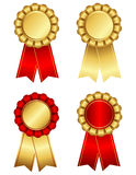 Award ribbon rosette in gold and red Stock Image