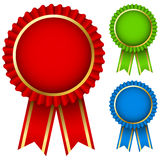 Award ribbon rosettes. Blank award ribbon rosettes in three colors isolated on white Royalty Free Stock Image