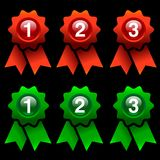 Award rosettes. Green and red award rosettes isolated on black background Royalty Free Stock Image