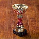 Award with space for text on wood background Royalty Free Stock Image