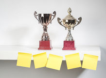 Award trophies. Displayed with sticky notes Royalty Free Stock Photo