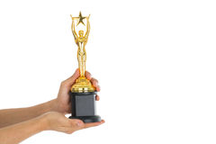 Award Trophy for winner achievement. After win competition Stock Photo