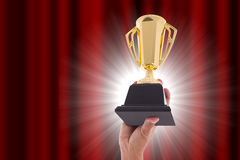 Award Trophy for winner achievement. After win competition Royalty Free Stock Photo