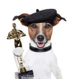 Award winner dog. Award winner director dog holding a statue Royalty Free Stock Photo