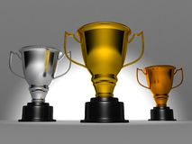Award winner trophy cups on dark background Stock Image