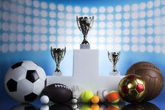 Sport podium, Cups of winners award. Award winning and championship concept, trophy cup on sport background Royalty Free Stock Image