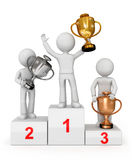 Awarded with cups winning trio on the podium. Winning concept - prize winners awarded with award cups on podium Stock Photo