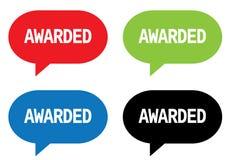 AWARDED text, on rectangle speech bubble sign. AWARDED text, on rectangle speech bubble sign, in color set stock illustration