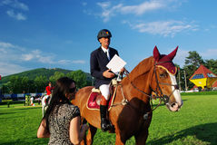 Awarding ceremony. Aurel Cojocariu with his horse Duende on the 4th place at CSIO2*-W & Balkan Tour, Piatra Neamt (Romania) 4-7 june 2009 Stock Photography