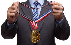Awarding gold medal. Businessman giving gold medal prize for success in business Stock Photo