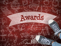 Awards against desk. The word awards and casual shoes against desk Royalty Free Stock Photo
