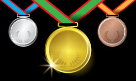 Awards as medals - gold, silver and bronze. The abstract of Medals in ai versions (ai/10), vector format Royalty Free Stock Image