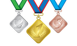 Awards as medals - gold, silver and bronze Royalty Free Stock Photos