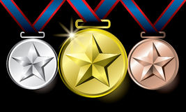 Awards as medals - gold, silver and bronze Royalty Free Stock Photography