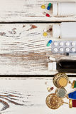 Awards and drugs on wood. Royalty Free Stock Images