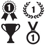 Awards icon set: Trophy cup, Laurel wreath, Badge and Medal. Royalty Free Stock Images