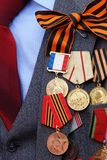 Awards and medals. On a breast of the veteran of war Stock Photos
