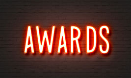 Awards neon sign. On brick wall background Stock Photos