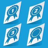 Awards sticker set. Set of four stickers with awards icons,  on blue Royalty Free Stock Image