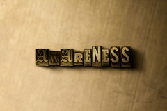 AWARENESS - close-up of grungy vintage typeset word on metal backdrop Royalty Free Stock Images