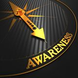 Awareness Concept on Golden Compass. Royalty Free Stock Images