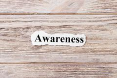 AWARENESS of the word on paper. concept. Words of AWARENESS on a wooden background.  Royalty Free Stock Photography