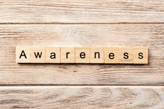 Awareness word written on wood block. awareness text on table, concept.  royalty free stock photography