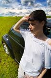Away from the city 1. A young woman enjoys the sun in an open field Royalty Free Stock Photography