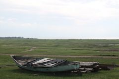 Away from home. Lonely boat on the background fields in anticipation of launching. The Volga River Stock Photo