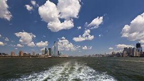 Away from the stress of a big city. Getting away from Manhattan NYC by water boat n a sunny afternoon Stock Photography
