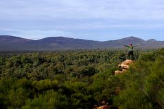 Awe-Inspiring Wilpena Pound. A woman hiking in part of the iconic Wilpena Pound in South Australia's Flinders Ranges, photographed from a ridge looking inside Stock Photography