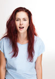 In awe. Portrait of a gorgeous young redhead woman with expression of awe Stock Photos