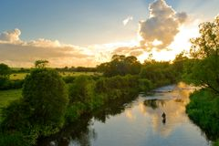 Aweg River. Fishing on Aweg River, Co.Limerick, Ireland at sunset Royalty Free Stock Photo