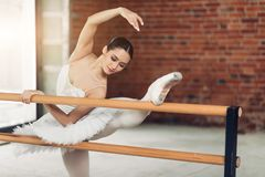 Awesome attractive girl practising classical ballet. extensive training. stock photo