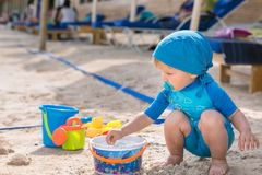 Beautiful child plays at the beach royalty free stock image