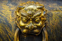 Awesome black and gold face on a wall stock image
