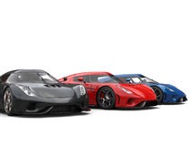 Awesome black, red, and blue supercars Stock Images
