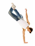Awesome breakdancing moves. Urban style street breakdancing handstand grab move done isolated on white in studio Stock Photos