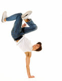Awesome breakdancing moves. Urban style street breakdancing handstand grab move done isolated on white in studio Royalty Free Stock Photography